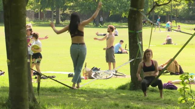 people meeting in parks in glasgow as coronavirus lockdown restrictions begin to be eased - glasgow stock videos & royalty-free footage