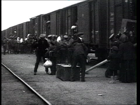 people migration : russian refugees get in train goods wagons , civilians w/ bundles and bags. - 1914 stock videos & royalty-free footage