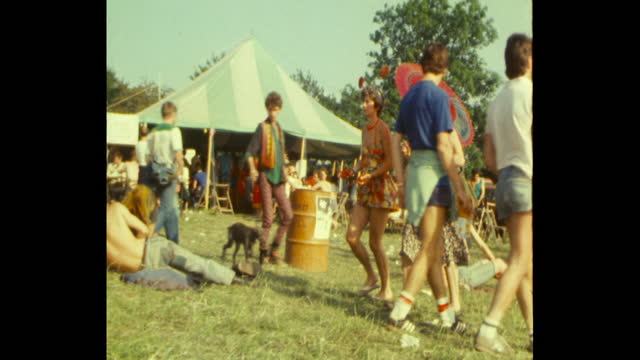 people milling about at 1983 glastonbury festival worthy farm somerset - 1983 stock videos & royalty-free footage