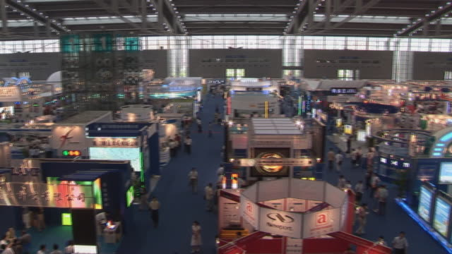 ha ws pan people milling around trade show in convention center/ shenzhen, china - tradeshow stock videos & royalty-free footage