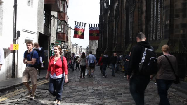 people most likely tourists are walking up and down the royal mile - royal mile stock videos and b-roll footage