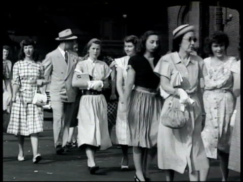 vídeos de stock, filmes e b-roll de people mostly women walking from ferry terminal in city urban street people crossing street w/ others walking down elevated train stairs bg large... - 1948