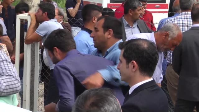 people mourn during funeral ceremony of the 13 victims, killed by pkk terrorist organization's bomb-laden truck attack in sur district of diyarbakir,... - 16 17 years stock videos & royalty-free footage