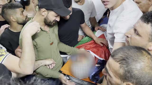 people mourn for a young palestinian named mohammed ishaq hamad killed on tuesday by israeli forces in the occupied west bank amid clashes, in... - gaza strip stock videos & royalty-free footage