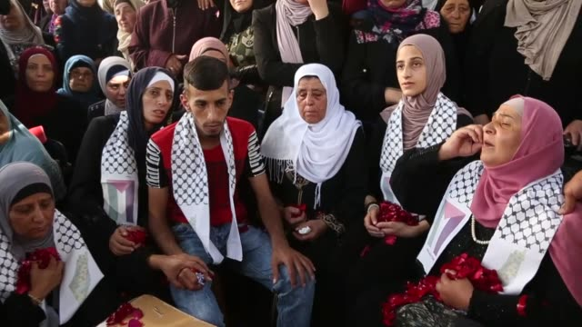 people mourn over the dead body of palestinian youth mohammad samir who was shot with live ammunition in the heart and the chest by israeli forces on... - ammunition stock videos and b-roll footage