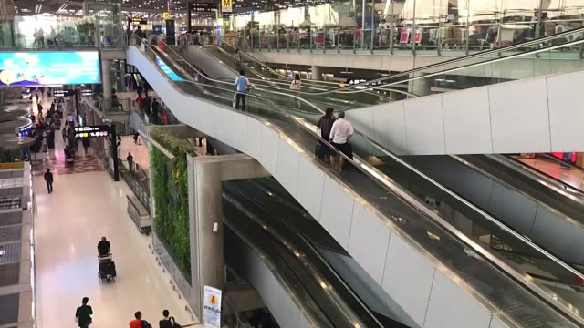 people movement at airport.(timelapse) - elevated walkway stock videos & royalty-free footage