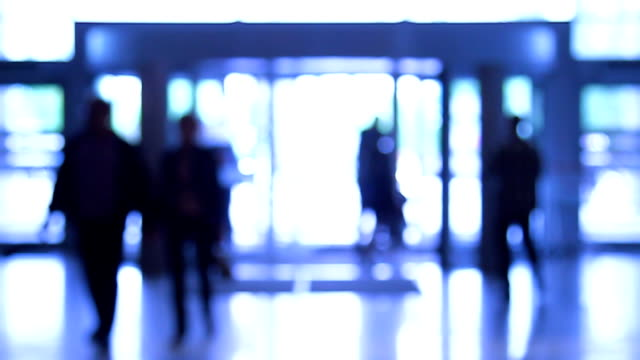 people moves through revolving door - defocussed stock videos & royalty-free footage