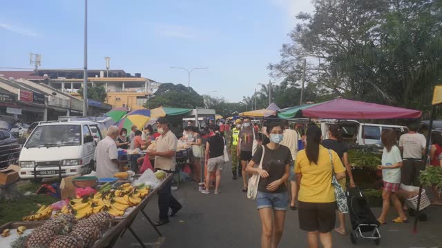 people moving at morning market outdoor with face mask - malaysian culture stock videos & royalty-free footage