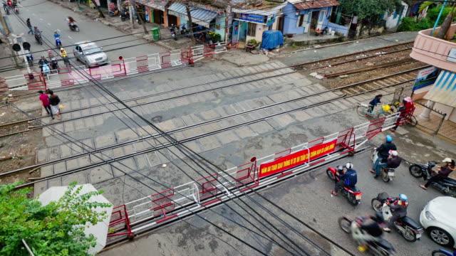 MS T/L People moving at Railway Crossing / Da Nang, Vietnam