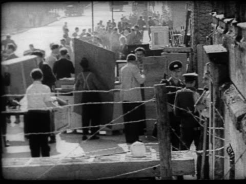 b/w 1961 people moving belongings in evacuation from border of east berlin / berlin wall / cold war - 1961 stock videos & royalty-free footage