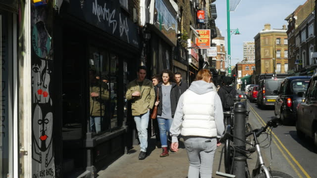 people moving in london shoreditch brick lane (uhd) - east london stock videos and b-roll footage