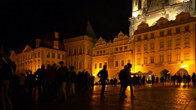 People Moving in Prague Old Town Square at Night