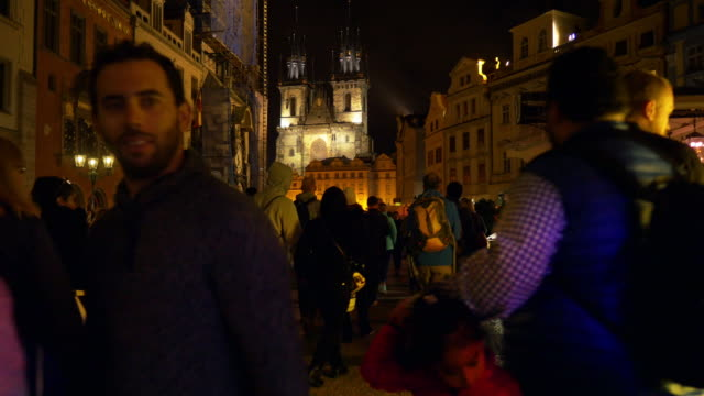 people moving in prague old town square at night - prague old town square stock videos & royalty-free footage