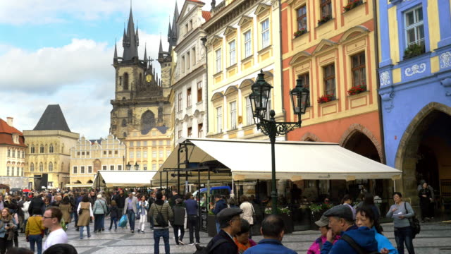 people moving in prague old town square - prague stock videos & royalty-free footage
