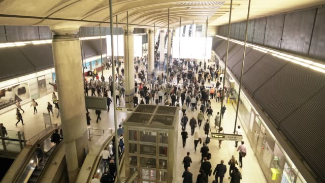 people moving in underground station at rush hour - tube stock videos & royalty-free footage