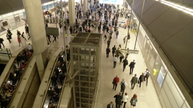 people moving in underground station at rush hour - real time footage stock videos & royalty-free footage