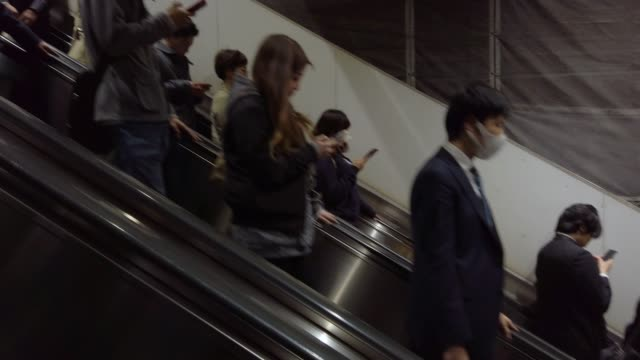 4k people moving on escalator - treno video stock e b–roll