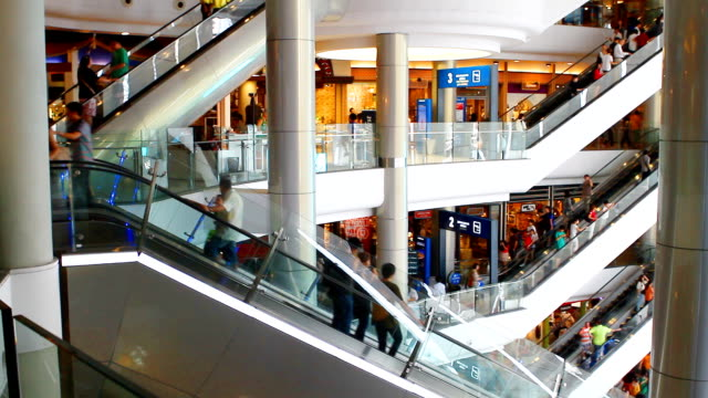 people moving on escalator. - department store stock videos & royalty-free footage