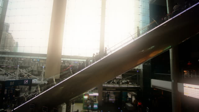 People moving on escalator