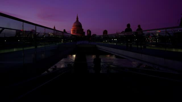 people moving on london millennium bridge at night - london millennium footbridge stock videos and b-roll footage