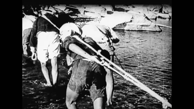 people moving on row boats / wading across the river / barge hauling - 1938 stock videos & royalty-free footage