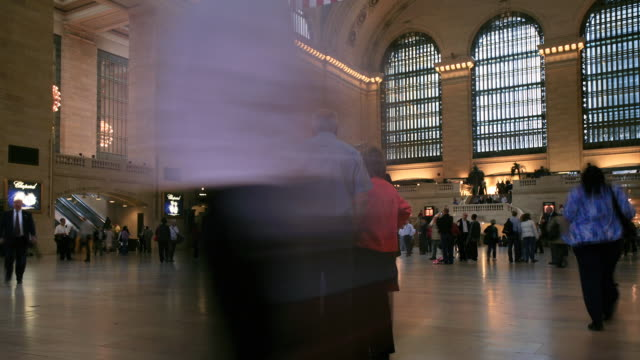 people moving through a train station - new york city penn station stock videos and b-roll footage