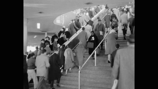 vídeos de stock, filmes e b-roll de people moving up and down on steps and escalator, new york city, new york state, usa - usa