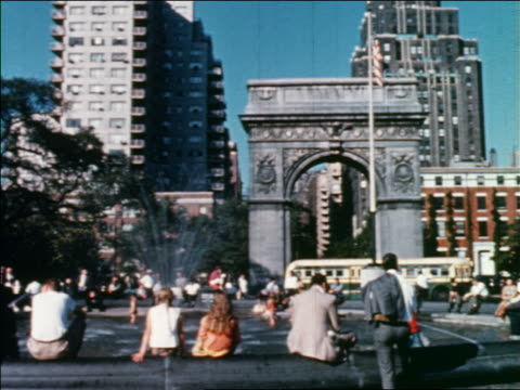 1960 people near fountain with arch in background / washington square park / greenwich village, nyc - greenwich village stock videos & royalty-free footage