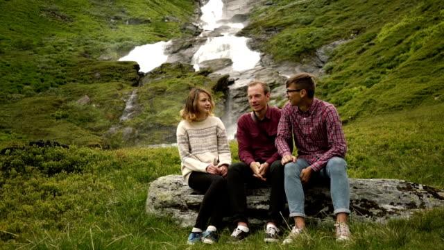 People near the waterfall