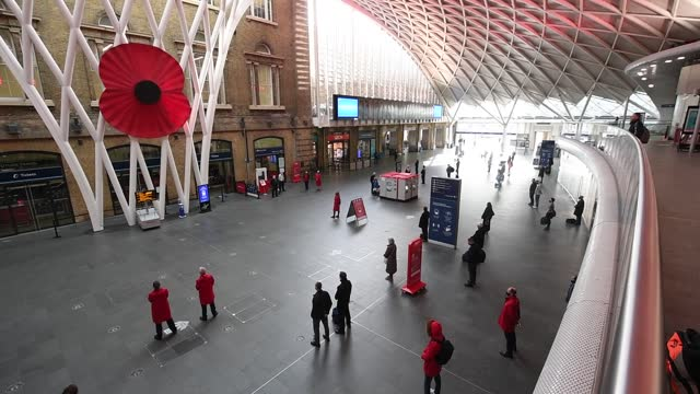 people observe a two-minute silence at king's cross station, london, as the nation falls silent to remember the war dead on armistice day. - armistice stock videos & royalty-free footage