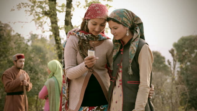people of himachal pradesh: beautiful young women using mobile phone - rural scene stock videos & royalty-free footage