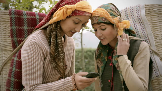 People of Himachal Pradesh: Beautiful young women using mobile phone