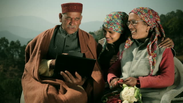 people of himachal pradesh: senior man using laptop with family - indian mom stock videos & royalty-free footage