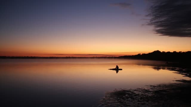 ELS People of the Kamayura tribe come to the lake at dawn to bathe and wash clothes The Kamayura people are an indigenous tribe that populated the...