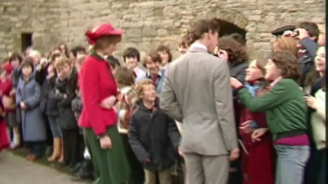 stockvideo's en b-roll-footage met people of wales remember charles and diana's first royal tour as271081014 / tx prince charles and diana along greeting crowds at caernarfon castle - 1981