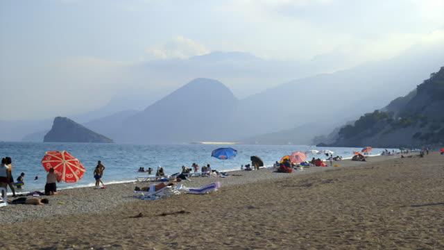 people on a beach on the turkish riviera - turkiet bildbanksvideor och videomaterial från bakom kulisserna