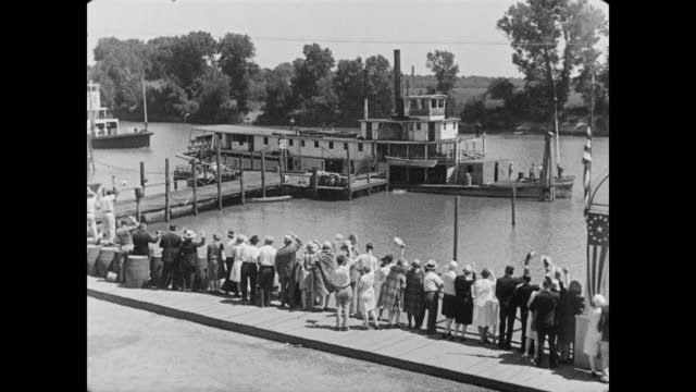 1928 people on a dock welcome the arrival of a new steamboat - 1928 stock videos & royalty-free footage
