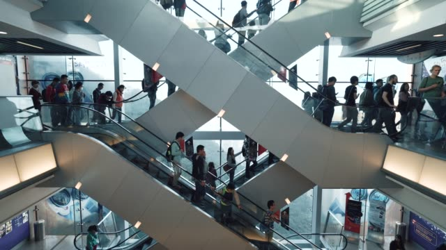 people on a escalator - lift stock videos & royalty-free footage