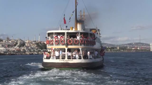 People on a ferry trip to July 15 Martyrs' Bridge to attend July 15 Democracy and National Unity Day's events to mark July 15 defeated coup's 1st...