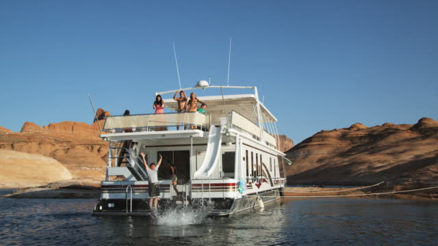 people on a houseboat