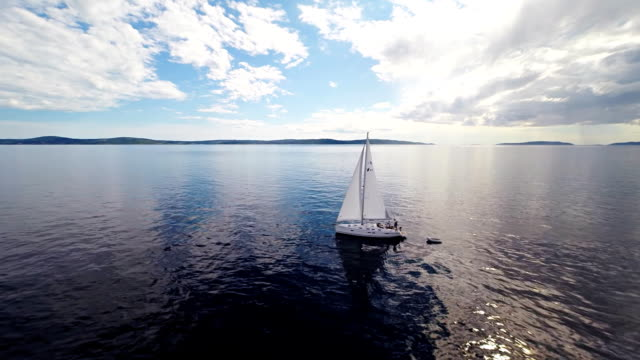 aerial ws people on a sailboat in the sea - sailing team stock videos & royalty-free footage