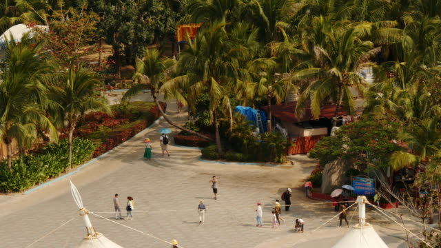 people on a square near the beach in sanya, hainan province, china. view from above. - spoonfilm stock-videos und b-roll-filmmaterial