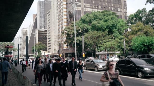 people on a street at sao paulo city's downtown - avenida paulista stock videos & royalty-free footage