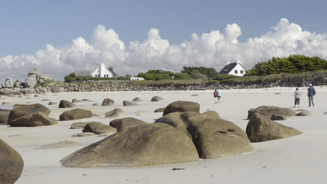 people on beach at low tide with rock formation - low tide stock videos & royalty-free footage