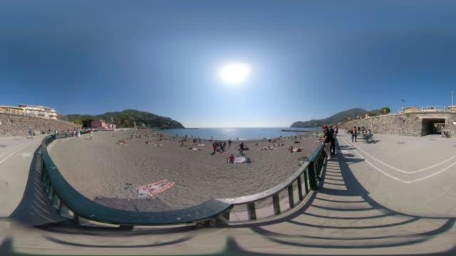 360 VR / People on beach at mediterranean sea