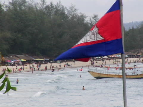 ws, ha, people on beach, cambodian flag in foreground, sihanoukville, cambodia - cambodia stock videos & royalty-free footage