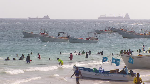 "people on beach in mogadishu, somalia - ""bbc news"" stock videos & royalty-free footage"