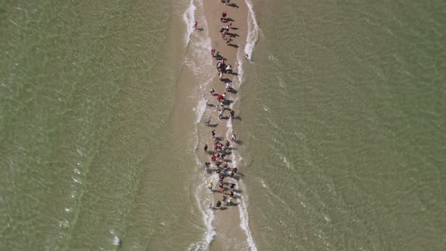 WS AERIAL ZI ZO People on beach/ Nordjylland, Denmark
