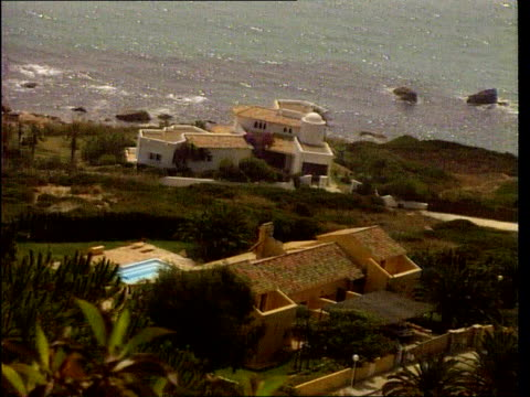 people on beach tgvs villa owned by noye lib madrid: int gv judges seated at hearing into extradition of noye side spectators at hearing - kenneth noye stock videos & royalty-free footage