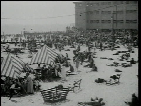 1918 ha people on beach with tents / brooklyn, new york, united states - coney island brooklyn stock videos & royalty-free footage